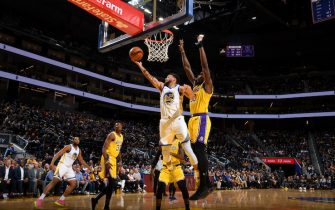 SAN FRANCISCO, CA - OCTOBER 18: Stephen Curry #30 of the Golden State Warriors shoots the ball against the Los Angeles Lakers during a pre-season game on October 18, 2019 at Chase Center in San Francisco, California. NOTE TO USER: User expressly acknowledges and agrees that, by downloading and or using this photograph, User is consenting to the terms and conditions of the Getty Images License Agreement. Mandatory Copyright Notice: Copyright 2019 NBAE (Photo by Noah Graham/NBAE via Getty Images)