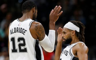 SAN ANTONIO, TX - OCTOBER 18: LaMarcus Aldridge #12 of the San Antonio Spurs and teammate Patty Mills #8 celebrate after Mills scored a 3-pointer during a preseason NBA game against the Memphis Grizzlies held at the AT&T Center on October 18, 2019 in San Antonio, Texas. The Spurs won 104-91. NOTE TO USER: User expressly acknowledges and agrees that, by downloading and or using this photograph, User is consenting to the terms and conditions of the Getty Images License Agreement.  (Photo by Edward A. Ornelas/Getty Images)