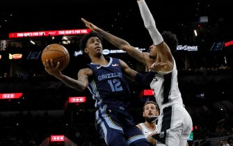 SAN ANTONIO, TX - OCTOBER 18: Ja Morant #12 of the Memphis Grizzlies shoots around Dejounte Murray #5 of the San Antonio Spurs as Rudy Gay #22 moves in on the play during a preseason NBA game held at the AT&T Center on October 18, 2019 in San Antonio, Texas. NOTE TO USER: User expressly acknowledges and agrees that, by downloading and or using this photograph, User is consenting to the terms and conditions of the Getty Images License Agreement.  (Photo by Edward A. Ornelas/Getty Images)