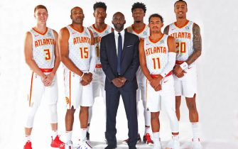 ATLANTA, GA - SEPTEMBER 30: Kevin Huerter #3, De'Andre Hunter #12, Lloyd Pierce, Trae Young #11, Cam Reddish #22, Vince Carter #15 and John Collins #20 of the Atlanta Hawks pose for a portrait during media day on September 30, 2019 at the Emory Sports Medicine Complex in Atlanta, Georgia. NOTE TO USER: User expressly acknowledges and agrees that, by downloading and/or using this photograph, user is consenting to the terms and conditions of the Getty Images License Agreement. Mandatory Copyright Notice: Copyright 2019 NBAE (Photo by Scott Cunningham/NBAE via Getty Images)