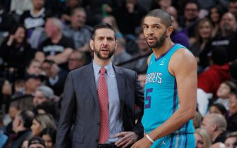 SACRAMENTO, CA - JANUARY 12: Head coach James Borrego of the Charlotte Hornets talks to Nicolas Batum #5 during the game against the Sacramento Kings on January 12, 2019 at Golden 1 Center in Sacramento, California. NOTE TO USER: User expressly acknowledges and agrees that, by downloading and or using this photograph, User is consenting to the terms and conditions of the Getty Images Agreement. Mandatory Copyright Notice: Copyright 2019 NBAE (Photo by Rocky Widner/NBAE via Getty Images)