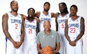 PLAYA VISTA, CA - SEPTEMBER 29: Kawhi Leonard #2, Patrick Beverley #21, Paul George #13, Head Coach Doc Rivers, Montrezl Harrell #5, and Lou Williams #23 of the LA Clippers pose for a portrait during media day on September 29, 2019 at the Honey Training Center: Home of the LA Clippers in Playa Vista, California. NOTE TO USER: User expressly acknowledges and agrees that, by downloading and/or using this photograph, user is consenting to the terms and conditions of the Getty Images License Agreement. Mandatory Copyright Notice: Copyright 2019 NBAE (Photo by Andrew D. Bernstein/NBAE via Getty Images)