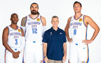 OKLAHOMA CITY, OK - SEPTEMBER 30: Chris Paul #3, Steven Adams #12, Head Coach Billy Donovan, and Danilo Gallinari #8 of the Oklahoma City Thunder pose for a portrait during media day on September 30, 2019 at Chesapeake Energy Arena in Oklahoma City, Oklahoma. NOTE TO USER: User expressly acknowledges and agrees that, by downloading and/or using this photograph, user is consenting to the terms and conditions of the Getty Images License Agreement. Mandatory Copyright Notice: Copyright 2019 NBAE (Photo by Zach Beeker/NBAE via Getty Images)