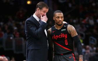 CHICAGO, ILLINOIS - MARCH 27:  Head coach Terry Stotts of the Portland Trail Blazers meets with Damian Lillard #0 in the third quarter against the Chicago Bulls at the United Center on March 27, 2019 in Chicago, Illinois. NOTE TO USER: User expressly acknowledges and agrees that, by downloading and or using this photograph, User is consenting to the terms and conditions of the Getty Images License Agreement. (Photo by Dylan Buell/Getty Images)