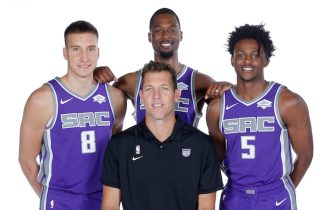 SACRAMENTO, CA - SEPTEMBER 27: Bogdan Bogdanovic #8, Head Coach Luke Walton, Harrison Barnes #40, and De'Aaron Fox #5 of the Sacramento Kings pose for a portrait during media day on September 27, 2019 at the Golden 1 Center & Practice Facility in Sacramento, California. NOTE TO USER: User expressly acknowledges and agrees that, by downloading and/or using this photograph, user is consenting to the terms and conditions of the Getty Images License Agreement. Mandatory Copyright Notice: Copyright 2019 NBAE (Photo by Rocky Widner/NBAE via Getty Images)