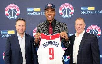 WASHINGTON, DC - JUNE 21:  Washington Wizards 2019 draft pick Rui Hachimura poses for a photo with Scott Brooks and Tommy Sheppard during a introductory press conference at Capital One Arena on June 21, 2019 in Washington, DC. NOTE TO USER: User expressly acknowledges and agrees that, by downloading and or using this photograph, User is consenting to the terms and conditions of the Getty Images License Agreement. (Photo by Ned Dishman/NBAE via Getty Images)