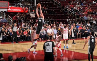 HOUSTON, TX - OCTOBER 16: Jakob Poeltl #25 of the San Antonio Spurs shoots the ball against the Houston Rockets during a pre-season game on October 16, 2019 at the Toyota Center in Houston, Texas. NOTE TO USER: User expressly acknowledges and agrees that, by downloading and or using this photograph, User is consenting to the terms and conditions of the Getty Images License Agreement. Mandatory Copyright Notice: Copyright 2019 NBAE (Photo by Bill Baptist/NBAE via Getty Images)