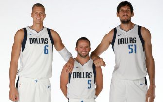 DALLAS, TX - SEPTEMBER 30: Kristaps Porzingis #6, J.J. Barea #5 and Boban Marjanovic #51 of the Dallas Mavericks pose for a portrait during Media Day on September 30, 2019 at the American Airlines Center in Dallas, Texas. NOTE TO USER: User expressly acknowledges and agrees that, by downloading and or using this photograph, User is consenting to the terms and conditions of the Getty Images License Agreement. Mandatory Copyright Notice: Copyright 2019 NBAE (Photo by Glenn James/NBAE via Getty Images)