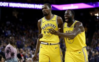 OAKLAND, CALIFORNIA - APRIL 02:  Kevin Durant #35 of the Golden State Warriors is escorted off the court by Draymond Green #23 after Durant was ejected from the game for complaining about a call during their game against the Denver Nuggets at ORACLE Arena on April 02, 2019 in Oakland, California.  NOTE TO USER: User expressly acknowledges and agrees that, by downloading and or using this photograph, User is consenting to the terms and conditions of the Getty Images License Agreement. (Photo by Ezra Shaw/Getty Images)