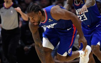 LOS ANGELES, CALIFORNIA - OCTOBER 22:  Kawhi Leonard #2 of the LA Clippers gets up with the help of Lou Williams #23 after his basket during a 112-102 win over the Los Angeles Lakers in the LA Clippers season home opener at Staples Center on October 22, 2019 in Los Angeles, California. (Photo by Harry How/Getty Images)