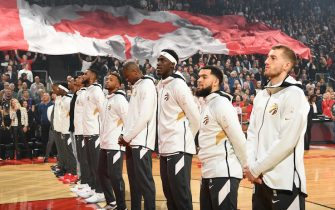 TORONTO, CANADA - OCTOBER 22: The Toronto Raptors stand for the National Anthem before the game against the New Orleans Pelicans on October 22, 2019 at the Scotiabank Arena in Toronto, Ontario, Canada. NOTE TO USER: User expressly acknowledges and agrees that, by downloading and or using this Photograph, user is consenting to the terms and conditions of the Getty Images License Agreement.  Mandatory Copyright Notice: Copyright 2019 NBAE (Photo by Ron Turenne/NBAE via Getty Images)