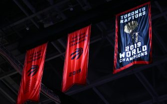TORONTO, ON - OCTOBER 22:  The Toronto Raptors Championship banner is revealed prior to the first half of an NBA game against New Orleans Pelicans at Scotiabank Arena on October 22, 2019 in Toronto, Canada.  NOTE TO USER: User expressly acknowledges and agrees that, by downloading and or using this photograph, User is consenting to the terms and conditions of the Getty Images License Agreement.  (Photo by Vaughn Ridley/Getty Images)