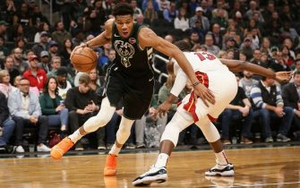 MILWAUKEE, WISCONSIN - MARCH 22:  Giannis Antetokounmpo #34 of the Milwaukee Bucks dribbles the ball while being guarded by Bam Adebayo #13 of the Miami Heat in the first quarter at the Fiserv Forum on March 22, 2019 in Milwaukee, Wisconsin. NOTE TO USER: User expressly acknowledges and agrees that, by downloading and or using this photograph, User is consenting to the terms and conditions of the Getty Images License Agreement. (Photo by Dylan Buell/Getty Images)