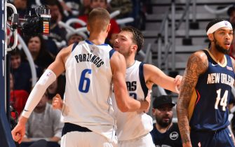 NEW ORLEANS, LA - OCTOBER 25: Kristaps Porzingis #6 and Luka Doncic #77 of the Dallas Mavericks react during a game against the New Orleans Pelicans on October 25, 2019 at the Smoothie King Center in New Orleans, Louisiana. NOTE TO USER: User expressly acknowledges and agrees that, by downloading and or using this Photograph, user is consenting to the terms and conditions of the Getty Images License Agreement. Mandatory Copyright Notice: Copyright 2019 NBAE (Photo by Jesse D. Garrabrant/NBAE via Getty Images)