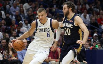 NEW ORLEANS, LOUISIANA - OCTOBER 25: Kristaps Porzingis #6 of the Dallas Mavericks drives the ball around Nicolo Melli #20 of the New Orleans Pelicans at Smoothie King Center on October 25, 2019 in New Orleans, Louisiana. NOTE TO USER: User expressly acknowledges and agrees that, by downloading and or using this photograph, User is consenting to the terms and conditions of the Getty Images License Agreement.  (Photo by Chris Graythen/Getty Images)