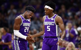 SACRAMENTO, CALIFORNIA - OCTOBER 25:   Buddy Hield #24 congratulates De'Aaron Fox #5 of the Sacramento Kings after he made a basket during their game against the Portland Trail Blazers at Golden 1 Center on October 25, 2019 in Sacramento, California.  NOTE TO USER: User expressly acknowledges and agrees that, by downloading and or using this photograph, User is consenting to the terms and conditions of the Getty Images License Agreement. (Photo by Ezra Shaw/Getty Images)
