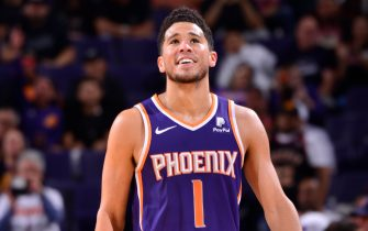 PHOENIX, AZ - OCTOBER 26: Devin Booker #1 of the Phoenix Suns smiles during a game against the LA Clippers on October 26, 2019 at Talking Stick Resort Arena in Phoenix, Arizona. NOTE TO USER: User expressly acknowledges and agrees that, by downloading and or using this photograph, user is consenting to the terms and conditions of the Getty Images License Agreement. Mandatory Copyright Notice: Copyright 2019 NBAE (Photo by Barry Gossage/NBAE via Getty Images)