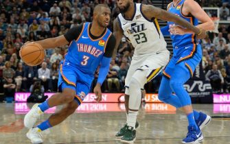 SALT LAKE CITY, UT - OCTOBER 23: Chris Paul #3 of the Oklahoma City Thunder drives around Royce O'Neale #23 of the Utah Jazz during an opening night game at Vivint Smart Home Arena on October 23, 2019 in Salt Lake City, Utah. NOTE TO USER: User expressly acknowledges and agrees that, by downloading and or using this photograph, User is consenting to the terms and conditions of the Getty Images License Agreement.  (Photo by Alex Goodlett/Getty Images)