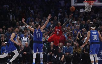DALLAS, TEXAS - OCTOBER 27:  Damian Lillard #0 of the Portland Trail Blazers takes a shot against Luka Doncic #77 of the Dallas Mavericks in the fourth quarter at American Airlines Center on October 27, 2019 in Dallas, Texas. NOTE TO USER: User expressly acknowledges and agrees that, by downloading and or using this photograph, User is consenting to the terms and conditions of the Getty Images License Agreement.  (Photo by Ronald Martinez/Getty Images)