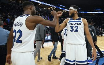 MINNEAPOLIS, MN -  OCTOBER 27: Andrew Wiggins #22 and Karl-Anthony Towns #32 of the Minnesota Timberwolves celebrate after a game against the Miami Heat on October 27, 2019 at Target Center in Minneapolis, Minnesota. NOTE TO USER: User expressly acknowledges and agrees that, by downloading and or using this Photograph, user is consenting to the terms and conditions of the Getty Images License Agreement. Mandatory Copyright Notice: Copyright 2019 NBAE (Photo by David Sherman/NBAE via Getty Images)