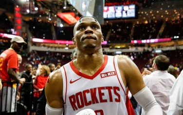 HOUSTON, TX - OCTOBER 26:  Russell Westbrook #0 of the Houston Rockets tosses his shoe to a fan after the game against the New Orleans Pelicans at Toyota Center on October 26, 2019 in Houston, Texas.  NOTE TO USER: User expressly acknowledges and agrees that, by downloading and or using this photograph, User is consenting to the terms and conditions of the Getty Images License Agreement.  (Photo by Tim Warner/Getty Images)