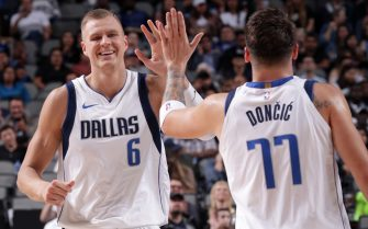 DALLAS, TX - OCTOBER 14: Kristaps Porzingis #6 high fives teammate Luka Doncic #77 of the Dallas Mavericks during a pre-season game against the Oklahoma City Thunder on October 14, 2019 at the American Airlines Center in Dallas, Texas. NOTE TO USER: User expressly acknowledges and agrees that, by downloading and or using this photograph, User is consenting to the terms and conditions of the Getty Images License Agreement. Mandatory Copyright Notice: Copyright 2019 NBAE (Photo by Glenn James/NBAE via Getty Images)