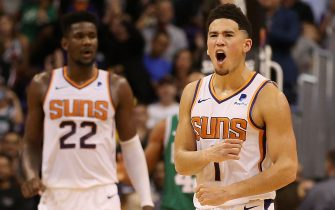PHOENIX, AZ - NOVEMBER 08:  Devin Booker #1 of the Phoenix Suns reacts alongside Deandre Ayton #22 after scoring against the Boston Celtics during the second half of the NBA game at Talking Stick Resort Arena on November 8, 2018 in Phoenix, Arizona. The Celtics defeated the Suns 116-109 in overtime. NOTE TO USER: User expressly acknowledges and agrees that, by downloading and or using this photograph, User is consenting to the terms and conditions of the Getty Images License Agreement.  (Photo by Christian Petersen/Getty Images)
