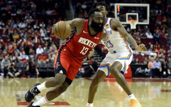 HOUSTON, TEXAS - OCTOBER 28: James Harden #13 of the Houston Rockets drives around Terrance Ferguson #23 of the Oklahoma City Thunder during the second quarter at Toyota Center on October 28, 2019 in Houston, Texas.NOTE TO USER: User expressly acknowledges and agrees that, by downloading and/or using this photograph, user is consenting to the terms and conditions of the Getty Images License Agreement.  (Photo by Bob Levey/Getty Images)