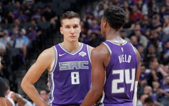 SACRAMENTO, CA - OCTOBER 25: Bogdan Bogdanovic #8 and Buddy Hield #24 of the Sacramento Kings face the Portland Trail Blazers on October 25, 2019 at Golden 1 Center in Sacramento, California. NOTE TO USER: User expressly acknowledges and agrees that, by downloading and or using this photograph, User is consenting to the terms and conditions of the Getty Images Agreement. Mandatory Copyright Notice: Copyright 2019 NBAE (Photo by Rocky Widner/NBAE via Getty Images)