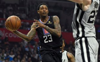 LOS ANGELES, CA - OCTOBER 31: Lou Williams #23 of the Los Angeles Clippers looks to pass against Jakob Poeltl #25 of the San Antonio Spurs during the first half at Staples Center on October 31, 2019 in Los Angeles, California. NOTE TO USER: User expressly acknowledges and agrees that, by downloading and/or using this Photograph, user is consenting to the terms and conditions of the Getty Images License Agreement. (Photo by Kevork Djansezian/Getty Images)