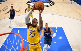 DALLAS, TX - NOVEMBER 1: LeBron James #23 of the Los Angeles Lakers dunks the ball against the Dallas Mavericks on November 1, 2019 at the American Airlines Center in Dallas, Texas. NOTE TO USER: User expressly acknowledges and agrees that, by downloading and/or using this Photograph, user is consenting to the terms and conditions of the Getty Images License Agreement. Mandatory Copyright Notice: Copyright 2019 NBAE (Photo by Jesse D. Garrabrant/NBAE via Getty Images)