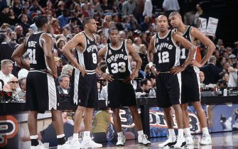 27 Mar 2002:  Antonio Daniels  #33 of the San Antonio Spurs waits on the court with his teammates Steve Smith #8, Malik Rose #31, Tim Duncan #21 and Bruce Bowen #12 during the game against the Portland Trail Blazers at the Rose Garden in Portland Oregon.  The Trail Blazers defeated the Spurs 98-93. NOTE TO USER:  User expressly acknowledges and agrees that, by downloading and/or using this Photograph, User is consenting to the terms and conditions of the Getty Images License Agreement. Mandatory copyright notice: Copyright 2001 NBAE Mandatory Credit: Sam Forencich /NBAE/Getty Images