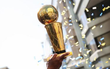 OAKLAND, CA - JUNE 12:  the Larry O'Brien Championship trophy is hoisted into the air during the Golden State Warriors Victory Parade on June 12, 2018 in Oakland, California. The Golden State Warriors beat the Cleveland Cavaliers 4-0 to win the 2018 NBA Finals. NOTE TO USER: User expressly acknowledges and agrees that, by downloading and or using this photograph, user is consenting to the terms and conditions of Getty Images License Agreement. Mandatory Copyright Notice: Copyright 2018 NBAE (Photo by Josh Leung/NBAE via Getty Images)