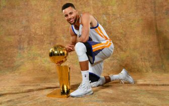 OAKLAND, CA - JUNE 12: Stephen Curry of the Golden State Warriors poses for a portrait with the Larry O'Brien Trophy after defeating the Cleveland Cavaliers in Game Five of the 2017 NBA Finals on June 12, 2017 at ORACLE Arena in Oakland, California. NOTE TO USER: User expressly acknowledges and agrees that, by downloading and or using this photograph, User is consenting to the terms and conditions of the Getty Images License Agreement. Mandatory Copyright Notice: Copyright 2017 NBAE (Photo by Jesse D. Garrabrant/NBAE via Getty Images)