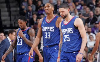 SACRAMENTO, CA - NOVEMBER 25: Lou Williams #23, Wesley Johnson #33 and Austin Rivers #25 of the Los Angeles Clippers look on during the game against the Sacramento Kings on November 25, 2017 at Golden 1 Center in Sacramento, California. NOTE TO USER: User expressly acknowledges and agrees that, by downloading and or using this photograph, User is consenting to the terms and conditions of the Getty Images Agreement. Mandatory Copyright Notice: Copyright 2017 NBAE (Photo by Rocky Widner/NBAE via Getty Images)