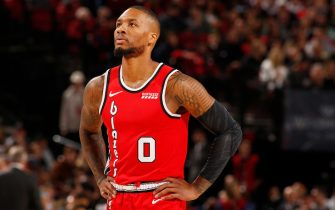PORTLAND, OR - NOVEMBER 2: Damian Lillard #0 of the Portland Trail Blazers looks on during a game against the Philadelphia 76ers on November 2, 2019 at the Moda Center Arena in Portland, Oregon. NOTE TO USER: User expressly acknowledges and agrees that, by downloading and or using this photograph, user is consenting to the terms and conditions of the Getty Images License Agreement. Mandatory Copyright Notice: Copyright 2019 NBAE (Photo by Cameron Browne/NBAE via Getty Images)