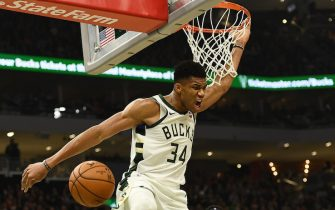 MILWAUKEE, WISCONSIN - NOVEMBER 02:  Giannis Antetokounmpo #34 of the Milwaukee Bucks dunks against the Toronto Raptors during the first half of a game at Fiserv Forum on November 02, 2019 in Milwaukee, Wisconsin. NOTE TO USER: User expressly acknowledges and agrees that, by downloading and or using this photograph, User is consenting to the terms and conditions of the Getty Images License Agreement. (Photo by Stacy Revere/Getty Images)