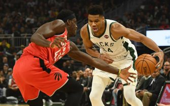 MILWAUKEE, WISCONSIN - NOVEMBER 02:  Giannis Antetokounmpo #34 of the Milwaukee Bucks is defended by Pascal Siakam #43 of the Toronto Raptors during the first half of a game at Fiserv Forum on November 02, 2019 in Milwaukee, Wisconsin. NOTE TO USER: User expressly acknowledges and agrees that, by downloading and or using this photograph, User is consenting to the terms and conditions of the Getty Images License Agreement. (Photo by Stacy Revere/Getty Images)