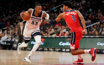 WASHINGTON, DC - NOVEMBER 02: Robert Covington #33 of the Minnesota Timberwolves dribbles the ball against Rui Hachimura #8 of the Washington Wizards in the first half at Capital One Arena on November 2, 2019 in Washington, DC. NOTE TO USER: User expressly acknowledges and agrees that, by downloading and or using this photograph, User is consenting to the terms and conditions of the Getty Images License Agreement. (Photo by Patrick McDermott/Getty Images)