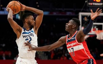 WASHINGTON, DC - NOVEMBER 02: Isaac Bonga #17 of the Washington Wizards defends Andrew Wiggins #22 of the Minnesota Timberwolves in the first half at Capital One Arena on November 2, 2019 in Washington, DC. NOTE TO USER: User expressly acknowledges and agrees that, by downloading and or using this photograph, User is consenting to the terms and conditions of the Getty Images License Agreement. (Photo by Patrick McDermott/Getty Images)
