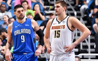 ORLANDO, FL - NOVEMBER 2: Nikola Vucevic #9 of the Orlando Magic standing with Nikola Jokic #15 of the Denver Nuggets during a game on November 2, 2019 at Amway Center in Orlando, Florida. NOTE TO USER: User expressly acknowledges and agrees that, by downloading and or using this photograph, User is consenting to the terms and conditions of the Getty Images License Agreement. Mandatory Copyright Notice: Copyright 2019 NBAE (Photo by Fernando Medina/NBAE via Getty Images)