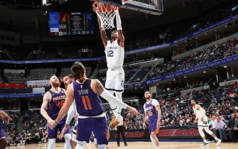 MEMPHIS, TN - NOVEMBER 2: Ja Morant #12 of the Memphis Grizzlies dunks the ball against the Phoenix Suns on November 2, 2019 at FedExForum in Memphis, Tennessee. NOTE TO USER: User expressly acknowledges and agrees that, by downloading and or using this photograph, User is consenting to the terms and conditions of the Getty Images License Agreement. Mandatory Copyright Notice: Copyright 2019 NBAE (Photo by Joe Murphy/NBAE via Getty Images)