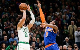 BOSTON, MA - NOVEMBER 1: Jayson Tatum #0 of the Boston Celtics shoots the game winning shot against R.J. Barrett #9 of the New York Knicks in the second half at TD Garden on November 1, 2019 in Boston, Massachusetts. NOTE TO USER: User expressly acknowledges and agrees that, by downloading and or using this photograph, User is consenting to the terms and conditions of the Getty Images License Agreement. (Photo by Kathryn Riley/Getty Images)