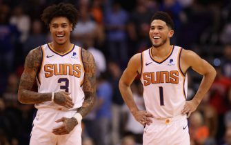 PHOENIX, ARIZONA - NOVEMBER 04: Kelly Oubre Jr. #3 and Devin Booker #1 of the Phoenix Suns react during the final moments of the second half of the NBA game against the Phoenix Suns at Talking Stick Resort Arena on November 04, 2019 in Phoenix, Arizona.  The Suns defeated the 76ers 114-109.  NOTE TO USER: User expressly acknowledges and agrees that, by downloading and/or using this photograph, user is consenting to the terms and conditions of the Getty Images License Agreement (Photo by Christian Petersen/Getty Images)