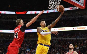 CHICAGO, ILLINOIS - NOVEMBER 05:  Kyle Kuzma #0 of the Los Angeles Lakers drives to the basket against Lauri Markkanen #24 of the Chicago Bulls during the first half  at United Center on November 05, 2019 in Chicago, Illinois. NOTE TO USER: User expressly acknowledges and agrees that, by downloading and or using this photograph, User is consenting to the terms and conditions of the Getty Images License Agreement. (Photo by Stacy Revere/Getty Images)
