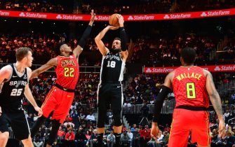 ATLANTA, GA - NOVEMBER 5: Marco Belinelli #18 of the San Antonio Spurs shoots the ball against Cam Reddish #22 of the Atlanta Hawks on November 5, 2019 at State Farm Arena in Atlanta, Georgia.  NOTE TO USER: User expressly acknowledges and agrees that, by downloading and/or using this Photograph, user is consenting to the terms and conditions of the Getty Images License Agreement. Mandatory Copyright Notice: Copyright 2019 NBAE (Photo by Scott Cunningham/NBAE via Getty Images)