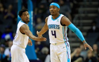 CHARLOTTE, NORTH CAROLINA - NOVEMBER 05: Teammates Malik Monk #1 and Devonte' Graham #4 of the Charlotte Hornets react after a play against the Indiana Pacers during their game at Spectrum Center on November 05, 2019 in Charlotte, North Carolina. NOTE TO USER: User expressly acknowledges and agrees that, by downloading and or using this photograph, User is consenting to the terms and conditions of the Getty Images License Agreement. (Photo by Streeter Lecka/Getty Images)