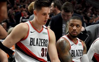 PORTLAND, OREGON - MAY 09: Damian Lillard #0 speaks with Zach Collins #33 of the Portland Trail Blazers during a time out in the second half of Game Six of the Western Conference Semifinals against the Denver Nuggets at Moda Center on May 09, 2019 in Portland, Oregon. The Blazers won 119-108. NOTE TO USER: User expressly acknowledges and agrees that, by downloading and or using this photograph, User is consenting to the terms and conditions of the Getty Images License Agreement. (Photo by Steve Dykes/Getty Images)