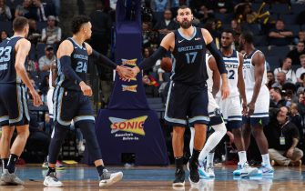 MEMPHIS, TN - NOVEMBER 6: Dillon Brooks #24 and Jonas Valanciunas #17 of the Memphis Grizzlies high five each other during the game against the Minnesota Timberwolves on November 6, 2019 at FedExForum in Memphis, Tennessee. NOTE TO USER: User expressly acknowledges and agrees that, by downloading and or using this photograph, User is consenting to the terms and conditions of the Getty Images License Agreement. Mandatory Copyright Notice: Copyright 2019 NBAE (Photo by Joe Murphy/NBAE via Getty Images)