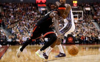 TORONTO, ON - NOVEMBER 06: Pascal Siakam #43 of the Toronto Raptors dribbles by Trevor Ariza #0 of the Sacramento Kings during second half of their NBA game at Scotiabank Arena on November 6, 2019 in Toronto, Canada. NOTE TO USER: User expressly acknowledges and agrees that, by downloading and or using this photograph, User is consenting to the terms and conditions of the Getty Images License Agreement. (Photo by Cole Burston/Getty Images)